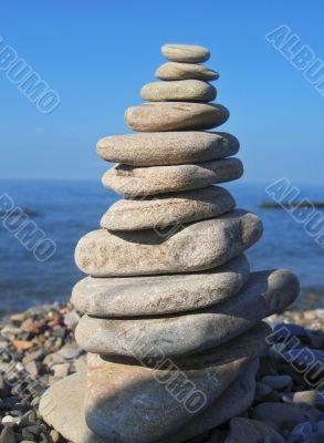 Balanced stones on the seashore