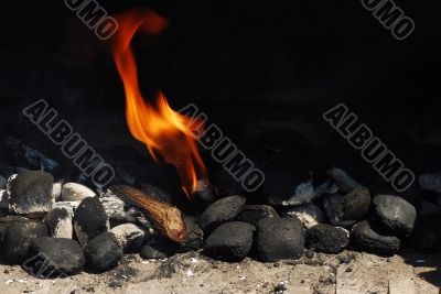 grill with coals and fire