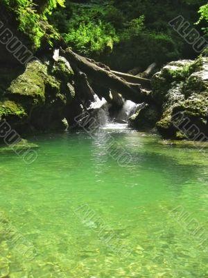 Waterfall between the rocks. The Caucasus nature