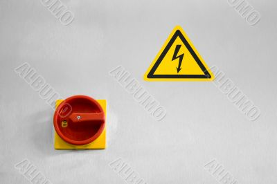 Main switch and a sign of dangerous voltage
