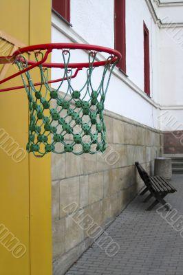 Basketball against a background of an empty school yard