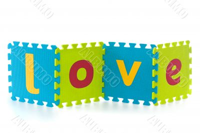 Love - sign with alphabet puzzle letters isolated on white backg