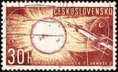 Postage stamp with spaceship, Sun, Mercury and Venus