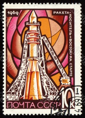 Post stamp with space rocket Vostok on launch pad