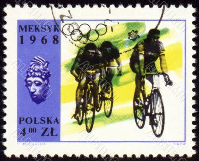 Group of cyclists on polish post stamp