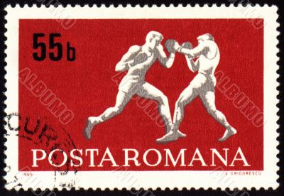 Fighting of two boxers on post stamp