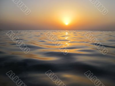 soft waves in warm sunset