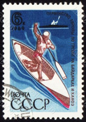 Canoe oarsman on post stamp