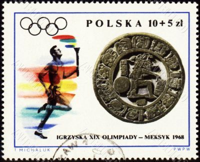 Sportsman with torch on post stamp of Poland