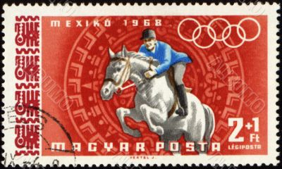 Jockey riding horse on post stamp