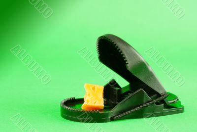 Black plastic mousetrap with bait