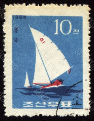 Yacht in a sea on post stamp