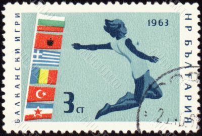 Jumping athlete on post stamp