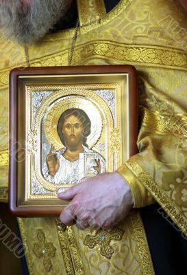 Priest with icon Jesus Christ