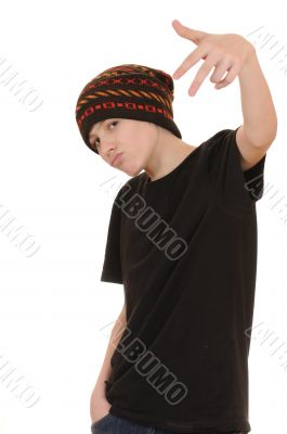 The teenager in a black vest and a hat