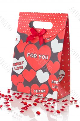 Red gift bag with hearts, isolated on white