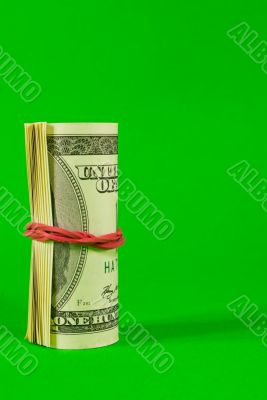 Roll of US dollars tied up with rubber