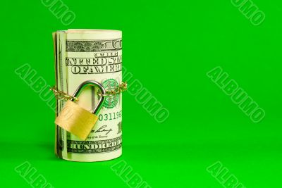 Roll of US dollars chained and locked