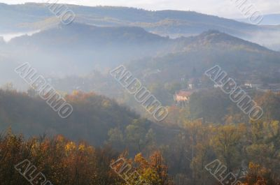 Foggy Hilly Terrain and Village