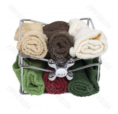 Bath Towels in a Basket with Faucet Handle