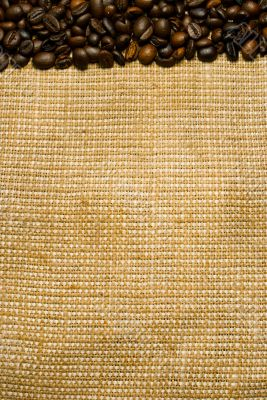 Background of the roasted coffee beans and burlap