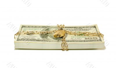 Stack of US 100 dollar bills chained and locked