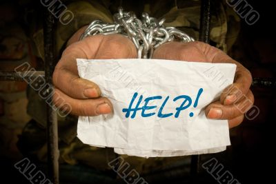 Man with hands tied with chain