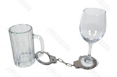 Handcuffs on Beer Mug and Wine Glass