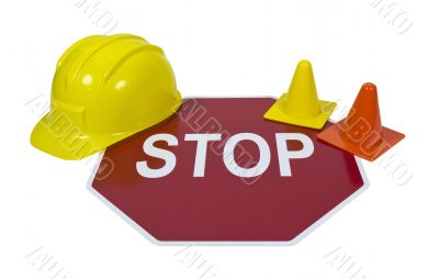 Stop Sign with Hard Hat and Safety Cones