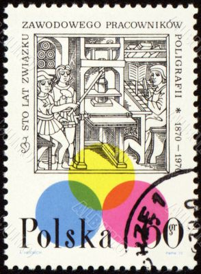 Medieval printing office on post stamp