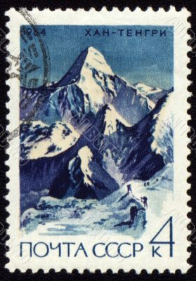 Khan Tengri peak in Central Tien Shan on post stamp
