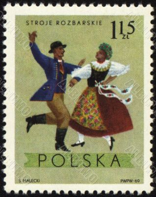 Polish folk dancers from Rozbarskie region on post stamp