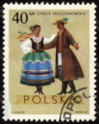 Polish folk dancers from Krzczonowskie region on post stamp