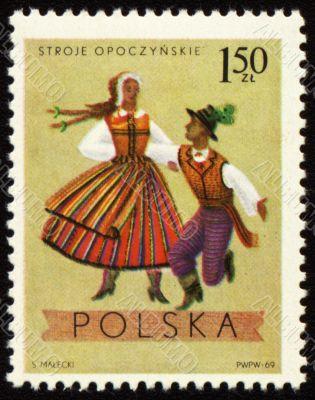 Polish folk dancers from Opoczynski region on post stamp