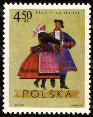 Polish folk dancers from Sadecki region on post stamp