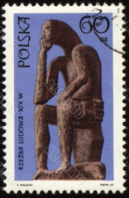 Statue of seated man on post stamp