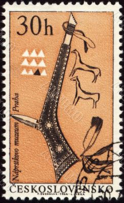 Tomahawk of American indian on post stamp