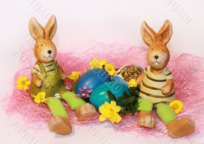 toy Easter rabbits and dyed eggs
