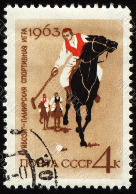 Guybozi - horse folk game in Pamir on post stamp