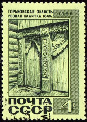 Old wooden wicket with carving on post stamp