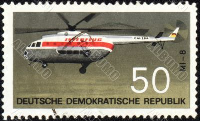 Flying helicopter Mi-8 on post stamp