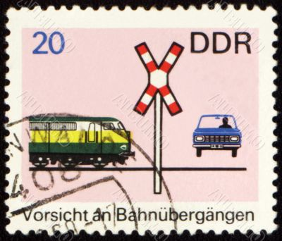Post stamp with car on a railway crossing