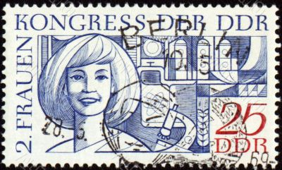 Portrait of young woman on post stamp