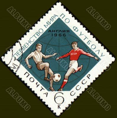 Football players on post stamp