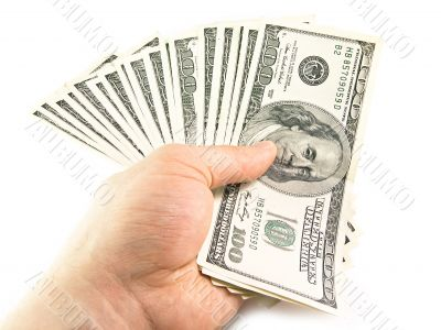 The isolated hundred dollar in a hand