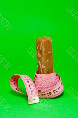 Chocolate bar with a pink metering tape