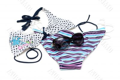 Sunglasses to rest upon swimsuit