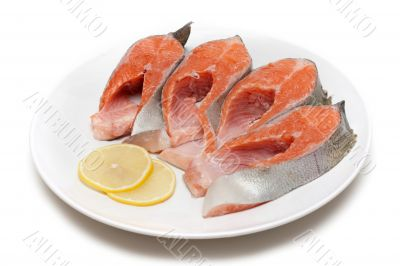 Red fish bit with lemon on plate