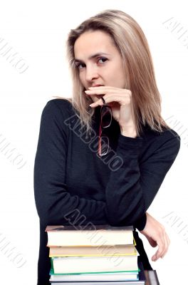Beautiful girl with spectacles and book