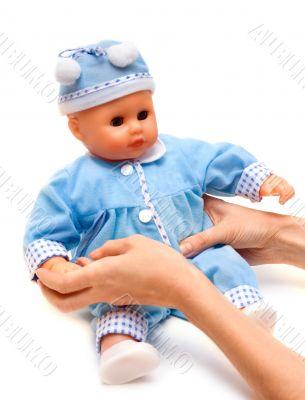 Nursery doll in blue suit